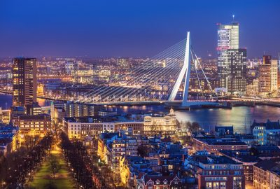 Erasmus Bridge over the Maas river and Rotterdam city skyline by night