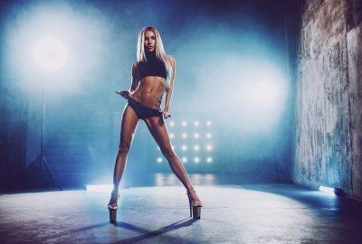 Sexy blonde stripper on stage in striptease club in Brisbane