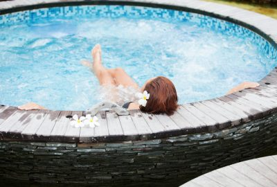 Asian masseuse in whirlpool of Dubrovnik spa club