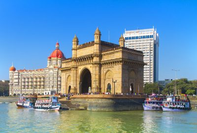 View of Gateway of India from the water with at the backdrop the Taj Mahal Palace and Tower Hotel