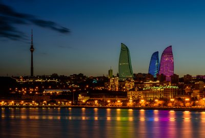 View from river at Flame Towers with night illumination in Baku