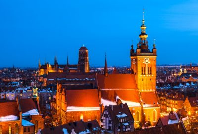 Winter evening view at St.-Catherines Church and St.-Mary`s basilica in Gdansk