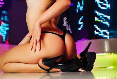 Latin dancer stripping in Santiago strip club