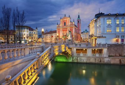 Tripple Bridge and Franciscan Church in Ljubljana at night