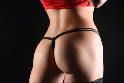 Muscat escort performing private striptease for client