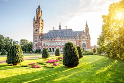 Peace Palace on sunny lawn in The Hague