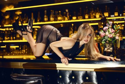 Sexy blonde crawling over the bar in Wellington striptease club
