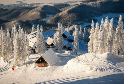 Snow-covered chalets in Poiana Brasov ski resort