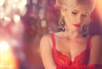 Beautiful blonde lady in boudoir-style brothel in Perth
