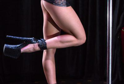 Bulgarian girl dancing the pole in a Brno striptease club