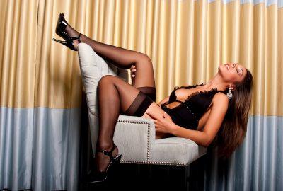 Latin escort from Valencia posing on chair