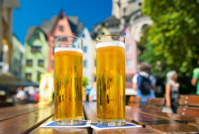 Two glasses of Kölsch beer to the backgdrop of Cologne's Old Town (Altstadt)