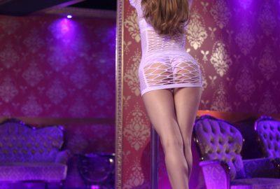Girl doing a pole dance in Naples striptease club