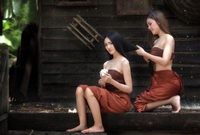 Two charming Thai masseuses sitting outside