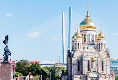 The Savior Transfiguration Cathedral in Vladivostok with cable-stayed bridge in the background