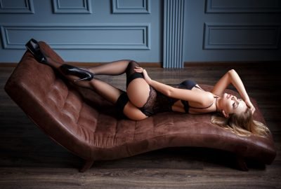 Beautiful Zagreb escort stretching out on chaise longue sofa