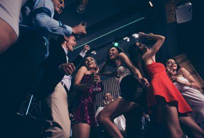 People partying on dance floor in Marseille swinger club