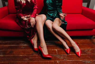 Freelance escorts on red sofa in hotel lobby in Tbilisi