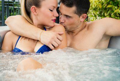 Couple in outdoor whirlpool of Toronto swinger club