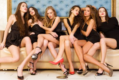 Six gorgeous hostesses on sofa in Basel brothel