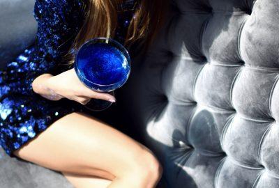 Montenegrin girl drinking a blue cocktail in a Budva club