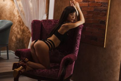 Sexy Bulgarian escort in Leuven posing on chair