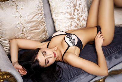 Beautiful Bordeaux escort stretching on sofa