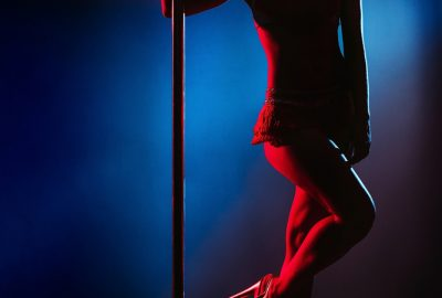 Sensual dancer at pole in bordeaux striptease club