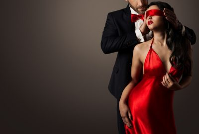 Stylish couple playing kinky game in swinger club in Bordeaux