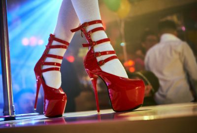 Japanese girl in sexy outfit and ultra high red heels on stage in Osaka image club